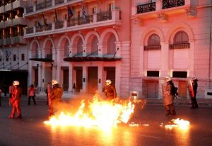 Greek police officers dodge petrol bomb during minor clashes in central Athens